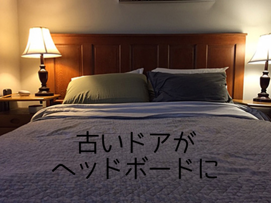 A headboard with two pillows and a bed