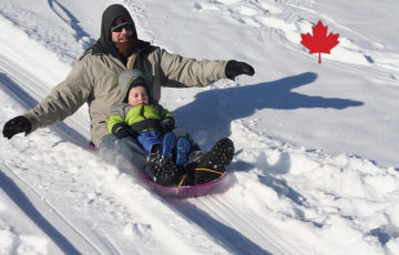 a man and son sledding