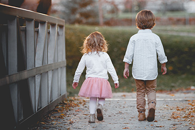 A little boy and a girl walking together