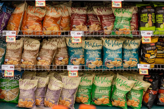 A shelf full of potato chip bags