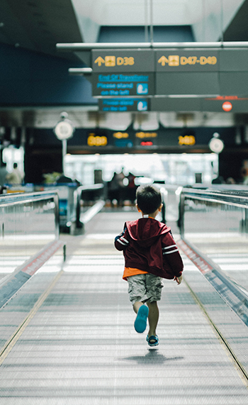 A boy running at the airport