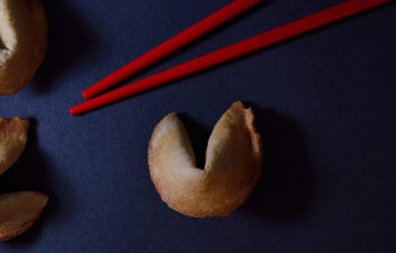 A fortune cookie and chopsticks