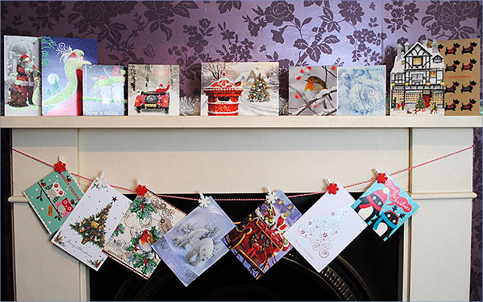 Christmas cards hanging from mantlepiece