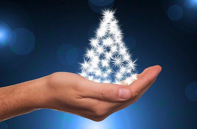 Christmas lights on the hand