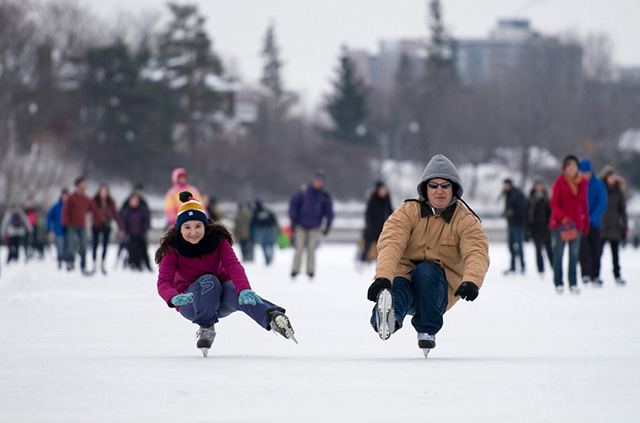 two people skating crouching