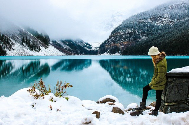 A woman looking at the lake
