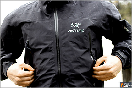A man wearing a black Arc'teryx jacket