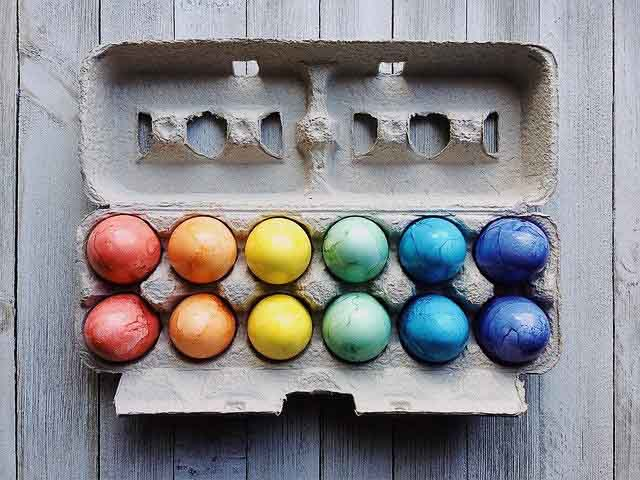 colorful easter eggs in the egg carton