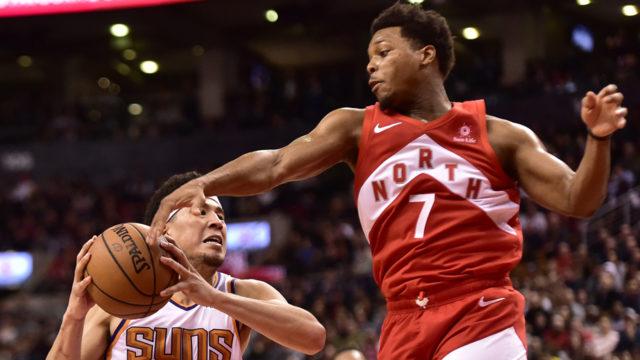 Toronto Raptors Lowry plying a basketball