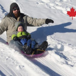 a man and son sledding