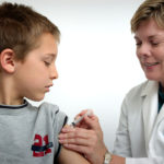 A boy getting a shot